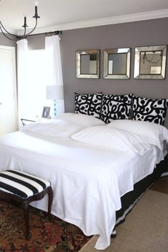 Our blogger Kyle shows how a clean white bed with dramatic throw pillows can make for the perfect guest bed. One hint: use Wrinkle Releaser.