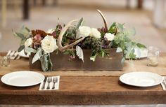 Antlers incorporated in centerpieces Vinewood Plantation | Katie & Taylor's Gallantly Rustic Wedding - Newnan, GA | Wedding Venue