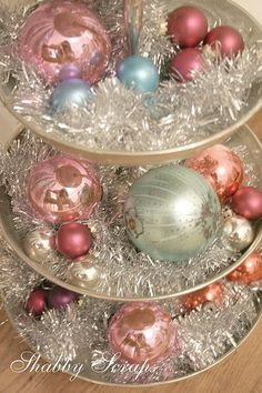 great shabby chic Christmas decor with tinsel & baubles-very pretty table centrepiece. Noel Christmas, Victorian Christmas, Vintage Christmas Ornaments, Retro Christmas, Christmas Crafts, Christmas Ideas, Silver Christmas, Christmas Balls, Christmas Mantles