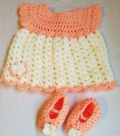 Baby Girl Crochet Dress Outfit, Peach and White Baby Dress, Baby Girl Dress and Shoes. This outfit consists of a Peach and white dress with matching shoes. Hand crocheted with soft baby yarn, she will be the peach of the party in this ensemble. Dress has peach colored bodice and hem with white skirt. Embellished with a peach and white flower on lower hem. Shoes are made using the same peach yarn with white flower adorning the toes. Built in strap across top of shoes keeps them on little…