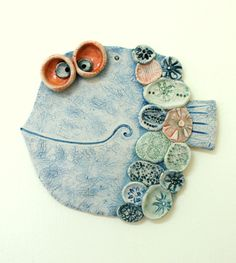 ceramic wall art...love this funny fish! Would be great for 2nd grade combining slab and medallion techniques plus scoring.