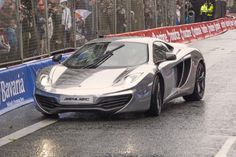 Coming in for the kill. ..Silver surfer McLaren MP4-12C on the wet track
