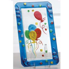 "Party Balloons Glass Platter Measures 15"" x 8.5"" Made of clear heavy glass. Decorated with red, yellow, blue and green balloons, confetti and streamers around the edges."