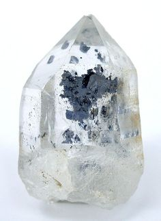Quartz with a molybdenite cluster inside.