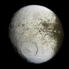 "Saturn's moon Iapetus, showing the bright trailing hemisphere. Part of the dark area appears on the right - the equatorial ridge is in profile on the right limb. The large crater Engelier is near the bottom; to its lower right is the rim of the partly obliterated, Gerin. (Cassini mosaic) Mona Evans, ""10 Amazing Facts about Saturn's Moons"" http://www.bellaonline.com/articles/art28136.asp"