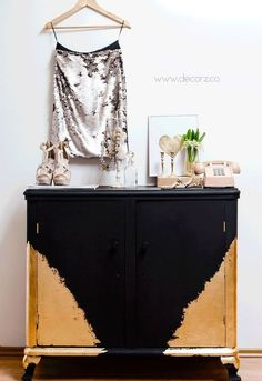 This piece of furniture was anything but perfect.  It was falling apart and well worn but a clever DIY'er gave it a new finish with black chalk paint and beautiful layers of gold leaf.