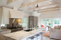 Modern white kitchen with vaulted ceilings. #crisp #kitchen