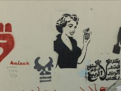 Caption: Graffiti by Kaizer, outside the al-Ahly Club in Zamalek, Cairo. Photo by Mona Abaza (Captured 8 June 2012)