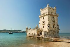 Belem Tower, Lisbon, Portugal - This is one of the city's attraction and a popular site for tourists. Discovering the history of the tower on the bank of the Tagus River and enjoying beautiful views of Lisbon port from the top are well worth your visit. Funchal, Visit Portugal, Spain And Portugal, Belem Portugal, Lisbon Airport, Day Trips From Lisbon, Portugal Travel Guide, Travel Europe Cheap, Barcelona