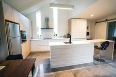 Recently finished Redwood home - Plywood breakfast bar, engineered stone bench top, melamine and thermowrap doors