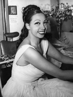 Josephine Baker...looks just like the girl next door in this pic.  MB