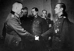 Generaloberst Georg Lindemann, commander of the 18. Armee, presents the Knight's Cross to Major Alfons Rebane, commander of the Estnische Bataillon 658 (Estonian voluntary battalion 658). Rebane was the first Estonian to receive the Knight's Cross and will become the most decorated and probably the most talented and charismatic Baltic soldier during WWII.