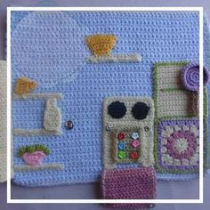 The Kitchen VIEW INTRODUCTION AND LINK PAGE HERE! SKILL LEVEL: Easy to Intermediate : Basic stitches, simple shaping and finishing. Concentration required for neat finishing. MATERIALS: Yarns: -scraps of double knitting/light worsted yarn in assorted colors (from 2 yards to 50 yards) – pink, blue, green, yellow, purple and white -6 x Large Press Button (Snap Fastener) -1 x Large Button, 2 x Small Button –…