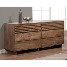 Give your bedroom a rustic feel with this six-drawer dresser from Heritage. Solid rubberwood construction gives this six-drawer dresser years of use, while natural cracks in the wood, along with weath