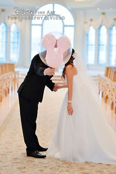 Only at Disney's Fairy Tale Weddings can you steal a kiss behind a Mickey Mouse balloon!