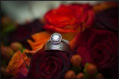 Elegant and classy white gold diamond halo engagement right with textured mens white gold wedding band on the beautiful bridal bouquet. Set made by Gary Shteyman of Persona Jewelry.