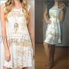 """Taupe and Ivory Tribal Print Flowy Dress MADE IN USA - this adorable sleeveless flowy dress features a taupe colored tribal print all over an Ivory bodice and round neckline. Fits slightly big for a flowy casual fit. S(4-6) M(8-10) L (12-14) Fabric Content: 95% Rayon, 5% Spandex. Apprx 36/37"""" long. Incredibly Soft and lightweight. You may purchase this listing as I've created individual listings for each size. My already low retail prices are firm unless bundled. ValMarie Boutique Dresses"""