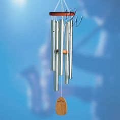 A personalized wind chime is not only a beautiful and soothing piece of home decor, but it can be a unique gift or tribute! Get yours today! || whimsicalwinds.com || #whimsicalwinds #windchimes #decor