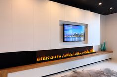 Linear Electric Fireplace using the Revolutionary ultrasonic technology Opti-Myst by Dimplex. The best alternative to the Gas Fireplaces. Handmade Cabinet Toronto