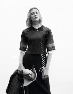 Annely Bouma wears quilted lace-up dress by Dior; ruffle-collar shirt by Valentino; cropped football top and tracksuit jacket (held in hand) from Angels The Costumiers