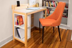 This project proves that a desk doesn't have to be big or bulky to offer lots of work and storage space. From storage trays under the desktop to the built-in tray at the back for charging devices to shelves underneath, it's packed with clever features that prove good things come in small packages.