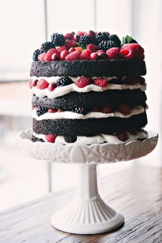 Rich chocolate cake with dark berries for fall nuptials. Nicole Berrett Photography #chocolatecake #nakedcakes #weddingcakes #rusticcakes