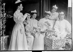 Nurses filling candy bags for the children's Christmas tree at Cook County Hospital, 1907, Chicago, Illinois. Photograph by Chicago Daily News, Inc.