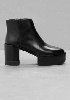 These smooth leather boots feature a chunky heel and welt that provide both a stable lift and urban edge.