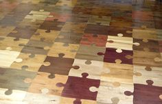 Really?!! Puzzle wood floor.  Interlocking, wood parquet floor.  Fun, unique, casual flooring that will surely make everyone smile who enters the room! ...Maybe for a finished basement