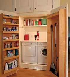 washing machine in the pantry...digging the door for storing broom