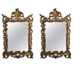 Wonderful Pair Of Italian Gilt Carved Wood Rococo Mirrors with Beveled Edges | From a unique collection of antique and modern wall mirrors at https://www.1stdibs.com/furniture/mirrors/wall-mirrors/