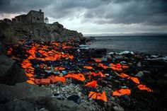 The Ciwem changing climate award 2016 is presented to Sandra Hoyn for her moving photograph 'Life Jackets on the Greek Island of Lesbos'. Hoyn, a German photojournalist, concentrates on social, environmental and human rights issues. Her winning photograph depicts the discarded life vests used by refugees to cross to Greece from Turkey, and hints at the enormity of the crises and dangers faced by the refugees.