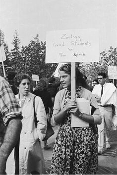 """Pickets with woman carrying sign saying """"Zoology Grad Students for Free Speech."""" Nov. 9, 1964. UC Berkeley."""