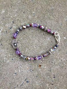 silver hamsa hand bracelet with purple Czech by blissfullyliss, $14.00