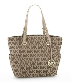 I have this exact purse and lalal love it  Michael Kors