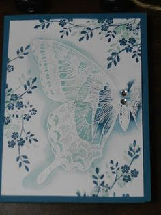 Stampin' Up! ... hand crafted card from Carol's Cards: Swallowtail ... blue and white ... emboss/resist ... shadow stamping too ... lovely!