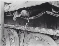 A dead Wehrmacht tanker with his head sticking out of the tank's side after fierce combat on the eastern front sometime 1943-44. #Germany #german #epic #badass #brave #rip #wow #cool #awesome #amazing #scary #wtf #soldier #man #rip #tank #omg #damn #shit #hero #worldwar2 #ww2 #world #history