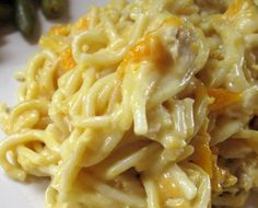 Cheesy Chicken Roteligetti 8 oz angel hair pasta 2 C chopped, grilled chicken 1 can cream of mushroom soup 1 can cream of chicken soup 1 10-oz can diced tomatoes & green chiles, undrained 8 oz sour cream Generous Sprinkling of Fresh Parmesan & Mexican-blend cheeses Preheat oven to 350 Cook pasta & drain well. Mix all other ingredients (except cheeses), add to cooked pasta & put in a 9 x 13 pan. Cover w/ foil, bake 30 mins or until hot & bubbly. Sprinkle w/ cheeses & return to oven to melt…