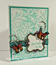 Rose Blossom Legacies:- March Stamp of the Month - The frame and sentiments are from Choose Happy.  I combined this set with the butterflies from Your Own Kind of Wonderful.  To create the background of this card, I rubbed lagoon pigment ink on the inside of the Floral embossing folder and then embossed the paper.