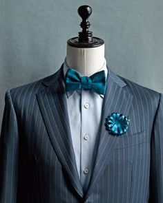 Bow tie.  Pinstripes.  Adorable boutonniere.