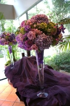 Decorative flower arrangements on purple tablecloth. Image of beautiful decorative flower arrangements of purple and pink flowers in tall glass vases on a purple tablecloth. Purple Wedding Tables, Purple Wedding Centerpieces, Purple Wedding Flowers, Wedding Flower Arrangements, Flower Centerpieces, Flower Decorations, Floral Wedding, Wedding Decorations, Floral Arrangements