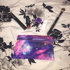 Glam bag Bombshell eyeliner in Wild Child, mini kabuki brush, and Befine food skin care exfoliating cleanser, lipstick in toasted, and concealer brush Makeup