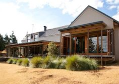 """Capturing the views was the starting point for the design of this home,"""" explains architect Vageli Zervogiannis 207 of this contemporary farmhouse in the KZN Midlands. Local Architects, 5 Bedroom House, House By The Sea, Building A New Home, Architect House, Plan Design, Country Life, New Homes, Home And Garden"""