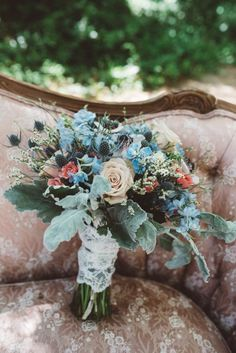 Dusty blue, peach, and sage bridal bouquet