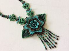 Huichol hand beaded necklace. Glass seed beads. Large flower, three dimensional…