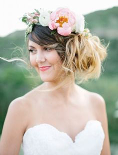 Beautiful messy side bun wedding hairstyle with chic pink flower crown; Featured Photographer: Lora Grady