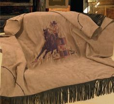 Very Soft Faux Suede By Inch Throw Blanket Embroidered With A Barrel Racer Turning Around A Barrel And Barbwire Detailing Edged On Two Sided With Faux