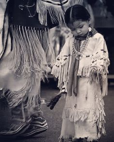 This photo was taken in Coeur d' Alene, Idaho by Rebecca Tifft. It shows the clothing style of a young Native American child. These long, cloth-type pieces can be seen worn in ceremonies and dances. Native Child, Native American Children, Native American Beauty, Native American Photos, Native American Tribes, American Indian Art, Native American History, American Girl, Clemente Orozco