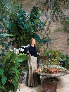 Interior designer Rose Uniacke in the conservatory of her London home.