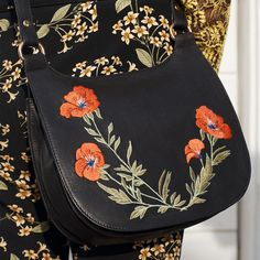Make a colourful cross-body bag your accessory of choice. Keep up the floral theme with an embroidered leather saddle bag or clash your colours and tie a printed scarf around a boxy colour-blocked style. #Topshop